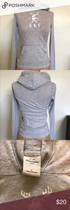 Abercrombie Kids Hooded T-shirt This is an Abercrombie and Fitch kids (girls) long sleeve hooded shirt.  Very thin and soft t- shirt material so it is perfect for those in between hot/cold days! Abercrombie & Fitch Tops Tees - Long Sleeve