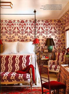 Miles Redd - A plethora of patterns enlivens a guest room, from a Farrow & Ball wallpaper to a vintage fabric on the Louis XVI settee and chair.
