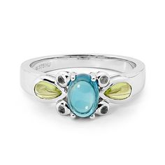 9ct White Gold Blue Topaz Ring with Amethyst & Peridot - Designed in our Highlands studio by our creative team this ring feature a candy coloured gemstones, set in 9 carat white gold. With a seamless marriage of vintage aesthetic and exquisite modern design.  Gemstone 1.6ct