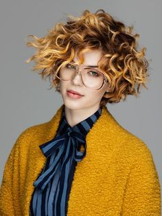 The latest hair fashion collection by Mitù makes hair wavy and big. Height is the main factor in making any texture look playful and touchable. Of course colors give this movement and height refine the look by giving hair dimension and highlights.