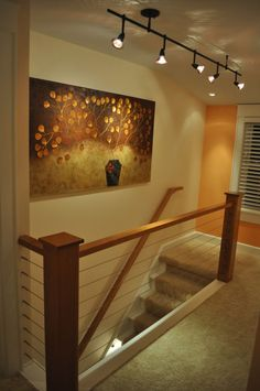 Choosing Terrific Picture Rail Lighting For Creating Your Lovely Interior Room Design : Mesmerizing Picture Rail Lighting In Charming Entrance Space Design With Comfy Light Orange Wall Color Combinations Also Lovely Light Wood Staircase And Splendid Carpet Flooring Ideas