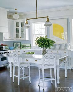 In East Hampton, the kitchen light fixture is from Ann-Morris Antiques, the stools are vintage Frances Elkins, and the lithograph is by Ellsworth Kelly.    - ELLEDecor.com