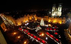 A Christmas tree is illuminated as the traditional Christmas market opens at the Old Town Square in Prague, Czech Republic