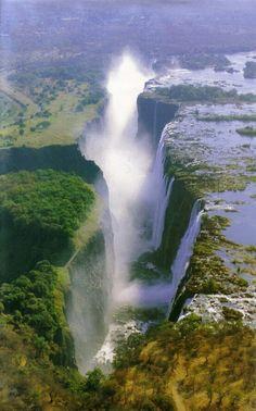Mosi-oa-Tunya (Tokaleya Tonga: the Smoke that Thunders) aka Victoria Falls, is a waterfall in southern Africa on the Zambezi River at the border of Zambia and Zimbabwe. Places Around The World, The Places Youll Go, Places To See, Around The Worlds, Beautiful Waterfalls, Beautiful Landscapes, Chutes Victoria, Beautiful World, Beautiful Places