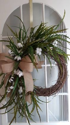 Lush and full Farmhouse cotton wreath with an abundance of cotton and greenery . perfect for your farmhouse decor. Farmhouse Cotton wreath , rustic wreath, front door wreath, cotton boll wreath,greenery wreath, farmhouse decor. Wreath is a 18 in grapevine base that measures 26x26