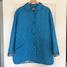 Women's Blue Burberry Quilted Coat Pre-owned but in excellent condition. 100% real. Size Large. Burberry Jackets & Coats
