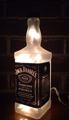 https://www.etsy.com/listing/215577214/jack-daniels-lighted-bottle-lamp see more at http://www.lightitupcreations.blogspot.com/?m=1  #bottle #seasonal #jackdaniels #lighted #lamp #whiskey #bar