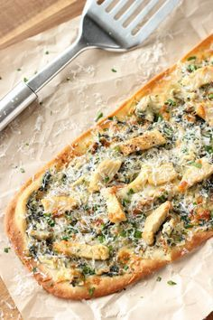 A Creamy Artichoke Spread On A Flat Bread Topped With Chicken For A Tasty Pizza