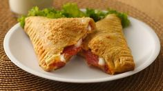 Crescent Pizza Pockets-Using Pillsbury® refrigerated crescent dinner rolls.