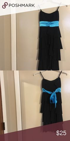 Middle School Prom Dress it's black and baby blue with ruffles and skinny straps. it has only been worn once. would look very pretty with a sparkly silver pin in the middle. Taboo Dresses Prom