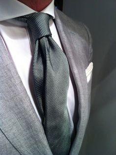 Grey linen suit jacket blazer, charcoal dark grey silk tie, white crisp shirt and pocket square