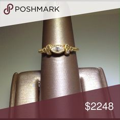 Gold & diamond ring 14kt yellow gold high fashion ring set with one Marquise cut diamond and 6 round champagne diamonds. With a matte finish. Jewelry Rings