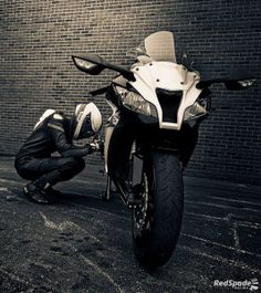 having a moment with her Kawasaki Zx10r sportbike,
