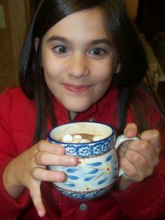 Seriously the BEST hot chocolate EVER!!!  I made this last night for a Christmas party with my besties and it was delish....will make you make the same face as the cutie above.  :) And you whip it up in the CROCKPOT! :D Here's what you need:     1.5 cups heavy cream  1 can of sweetened condensed milk (14oz)  2 cups milk chocolate chips  6 cups of milk  1 tsp vanilla extract    add everything into the crockpot and cook on low for two hours whisking often.  Whisk before you serve.  You're welcome! ;)