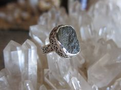 A personal favorite from my Etsy shop https://www.etsy.com/listing/234153740/czech-moldavite-sterling-silver-ring-sz