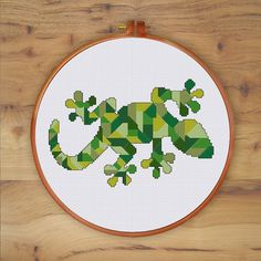 This modern mosaic design of gecko cross stitch is a fun handmade project to do with wonderful result. The shades of green will make your room so lively.  PATTERN SPECIFICATIONS: Stitches : full cross stitch, back stitch, three quarter stitch Colors: DMC stranded cotton Required Colors: 8 Stitch size: 98 x 64  Suggested fabric: 14 count Aida Strands: 2 Designed area: 7 x 4.57 inches or 17.8 x 11.6 cm  This PDF pattern contains: - Cover - Floss Palette - Color Symbol Chart - Black and White…