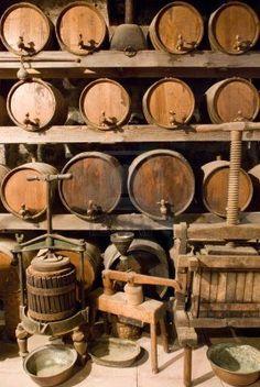 Wine barrels stacked in the old cellar of a winery. #taninotanino #vinosmaximum