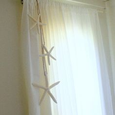 Hang a garland from curtain rod. Ocean Nursery, Nautical Nursery, Corner Window Treatments, Beach Curtains, Cottage Dining Rooms, Tropical Bedrooms, Seaside Decor, Beach Room, Big Girl Rooms