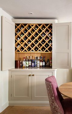 This gorgeous bespoke pantry larder with a built in wine rack is not only beautiful to look at, but keeps your wines and spirits safe and out of sight for a clean and streamline look. A quartz worktop Large Wine Racks, Wine Rack Bar, Built In Wine Rack, Wine Rack Storage, Wine Rack Cabinet, Wine Hutch, Wine Rack Shelf, Wine Crates, Tv Storage