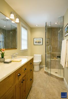 Newton master bath includes a new walk-in shower with a bench.