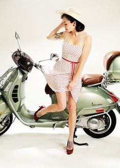 #ridecolorfully  Vintage #vespa + polka dot dress + red patent pumps + colorful tattoos = modern pin-up girl  Snagged by Illusive Photography, via Flickr