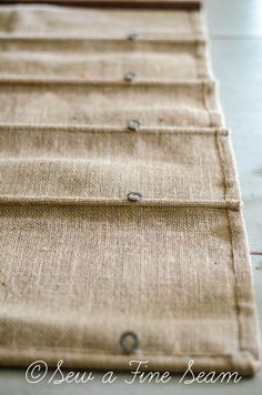 Roman shades - Use tension rod at top instead of cutting a piece of wood (plus then you can wash it). Super simple instructions on how to sew a Burlap Roman Shade