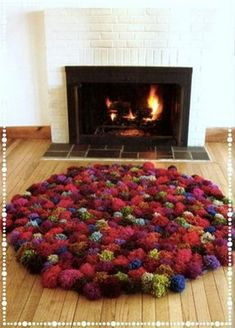 A rug made from pom poms which are made from old t-shirts.  My daughter would love this!