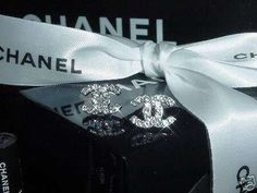 Chanel earrings. Simple and elegant, have mine already so they'll be my 'something old' when my wedding comes around :)