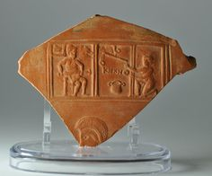 Roman terra sigillata plate lanx fragment with Circe, 4th-5th century A.D. African red slip ware plate lanx fragment, North Africa, from Pegasus Tablet, with Circe make a poison, inscribed KYPKHO, 15 cm long. Private collection