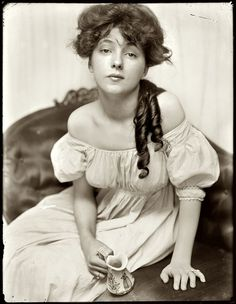 This is the original portrait of Evelyn Nesbit, the original femme fatale. Try doing a Goggle search on her name for some fascinating reading about a scandal and murder surrounding this young chorus girl turned artist's model.