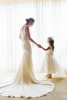 Heart-melting bride and flower girl moment: Photography : Jana Williams Photography Read More on SMP: http://www.stylemepretty.com/little-black-book-blog/2016/05/11/wedding-gown-dream-dress-status/