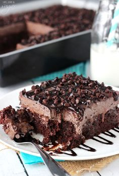 Devil's food poke cake with a chocolate whip and chocolate chips: