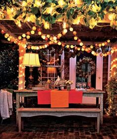 Just add wine and friends...Love this outdoor space with string lights.  (Small Place Style)