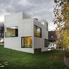 Blocky concrete homes do not amuse me.  House in Menzingen by Amrein Herzig   HomeAdore
