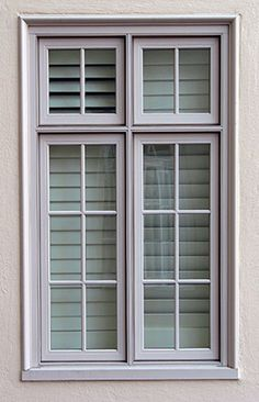 Windsor Pinnacle Clad White Casement Windows Exterior