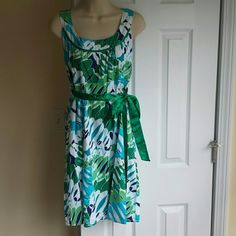 Vintage Dress Printed dress, beautiful round cleavege, A-line, zipper in the back, bow can be tied in the front or back however you like it. Lenght is about 38 inches. Chest width about 18 inches. Waist  17 1/2 inches. Material is100% cotton. Lined Vintage Dresses