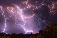 Lightning in an ash cloud that extends ten kilometres high, june 5th 2011 eruption of Puyehue volcano, Southern Chile. Photo by Francisco Negroni http://nubbsgalore.tumblr.com/post/89706661599/lightning-illuminates-an-ash-cloud-that-extends