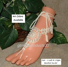 Enjoy these lace crochet barefoot sandals in white or ivory.  These women anklets are the perfect bridal foot jewelry or beach wedding shoes.  Footless sandles that would s... #crochetbarefoot