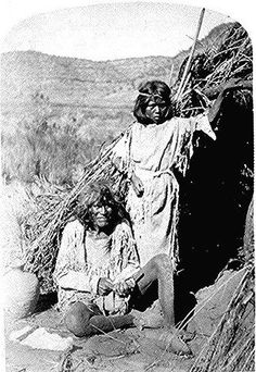 The Arrow Maker and his daughter, Kaivavit Paiutes, in front of their home, northern Arizona. Photographed by Clement Powell, October 4, 1872. American Indian Select List number 83.