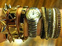 @StaceyRhodesBtq layering CC Skye gold pyramid stud & screw head bangles with a wrap bracelet & watch!