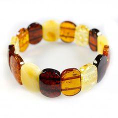 Bracelet d'ambre multicolore de taille adulte, parfait pour toutes les occasions. Ce bracelet est monté sur un gros élastique pour s'adapter au mieux à votre poignet. Hauteurdes pierres : 2 cm Poids approximatif : 18 grammes. Circonférence: 18 cm