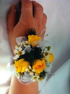 Yellow Spray roses and black accents on a wrist corsage for Prom.  expressions24-7.com