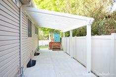 Build a patio pergola attached to the house to extend your living space to the yard. A DIY pergola creates a room outside for entertaining and gathering. Small Pergola, Modern Pergola, Pergola Attached To House, Metal Pergola, Pergola With Roof, Covered Pergola, Pergola Cover, Patio Roof, Corner Pergola