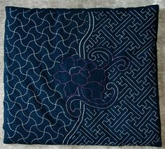 """Sashiko,  literally translated to """"little stabs"""", is a form of decorative reinforcement stitching, usually running stitch, for areas on clothing that get a lot of wear."""