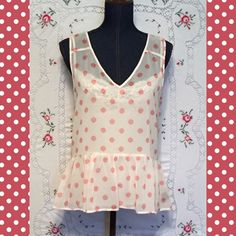 "SANCTUARY Top from Anthropologie SANCTUARY sheer high/low top from Anthropologie. Pink polka-dots and a ruffled bottom make this top so cute! The front length is 24.5""; the back is a few inches longer. Anthropologie Tops Blouses"