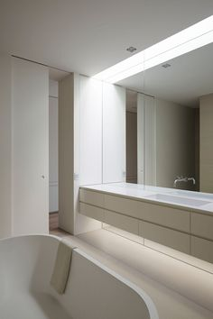 Carry the mirror down to the floor under the vanity, creates a beautiful extension of space. Davis Avenue by Orchard Piper. #minimal #bathroom #mirror
