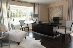 Like the window treatments on the bay window and the furniture layout - not furniture, too contemporary
