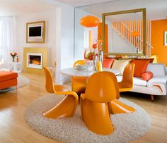 There are two different forms of the color orange in this space. The repetition of the same hue makes this room monochromatic. - emphasis