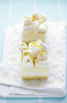 lemon and almond paste sponge, topped with layers of lemon cream, buttermilk panna cotta and topped with baked meringue sticks