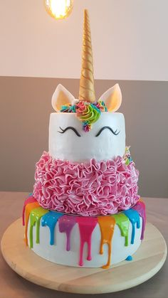 Unicorn birthday cake. Rainbow drip, pink ruffle, unicorn cake